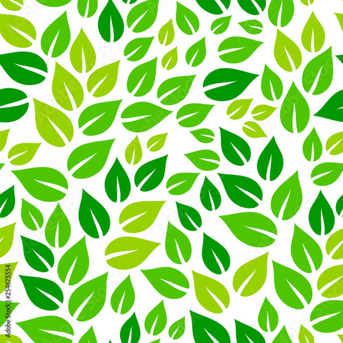 Fresh green leaves on white spring season seamless pattern, vector © natalyon