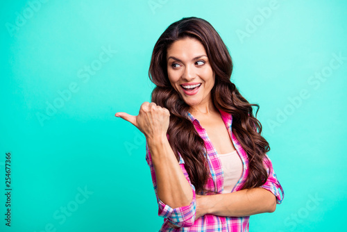 Close up photo beautiful amazing she her lady hand arm finger look amazed empty space advising new product wearing casual plaid checkered pink shirt outfit isolated teal bright vivid background