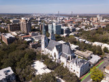 Aerial view of downtown Savannah, Georgia with Cathedral of St John in the foreground