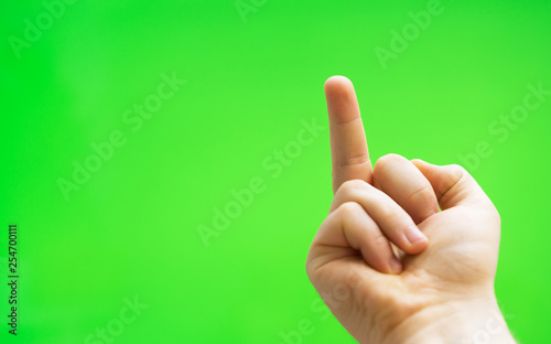 Male hand shows middle finger. Chroma key. Place for your advertisement. - 254700111