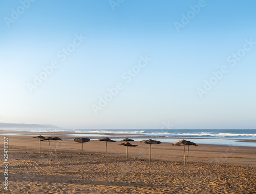 Coast of Sidi Kaouki, Morocco, Africa.  Coast with umbrellas. morocco's wonderfully sleepy surf town