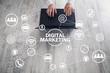 Hands typing on laptop keyboard in office desk. Concept of Digital Marketing