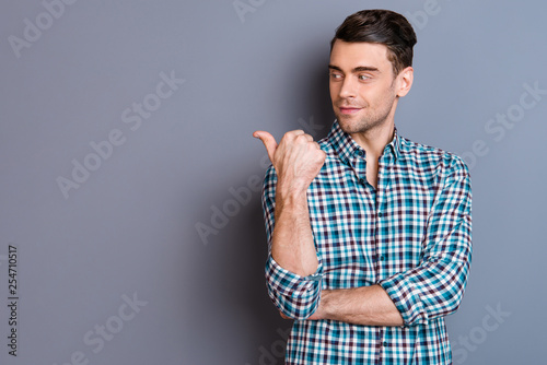 Close up photo attractive amazing he him his man hands arms finger show look empty space interested curious perfect hair styling wearing casual plaid checkered outfit isolated grey background