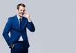 Leinwanddruck Bild - young businessman in glasses, against grey