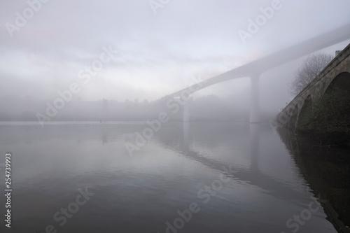 Misty Douro river bridge