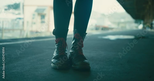 Close up on the feet of woman standing on train station platform