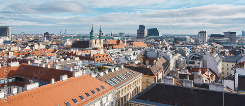 City of Vienna, Austria, January 16, 2019, View of the city of Vienna over the roofs of homes and the pigeons of the sunny city