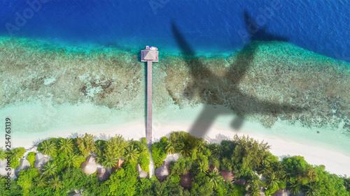 Leinwanddruck Bild Concept of airplane travel to exotic destination