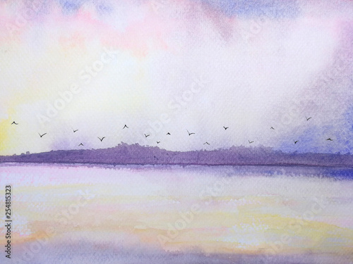 watercolor sea and mountain landscape pink sunset and birds flying in the sky. © atichat