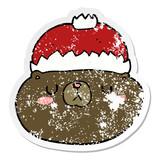 distressed sticker of a cartoon christmas bear
