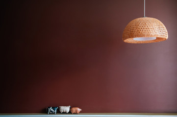 Ceramic animal doll figure and pendant lamp with Merlot red wall background © PixHound