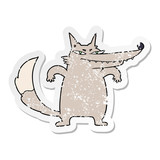 distressed sticker of a sly cartoon wolf