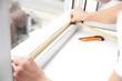 Leinwanddruck Bild - Young worker installing window in flat