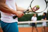 Group of healthy happy friends at the club playing tennis - 254850384