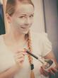 Leinwanddruck Bild - Happy young woman applying mud mask on face