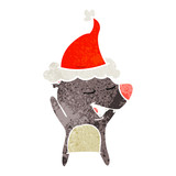 retro cartoon of a bear wearing santa hat