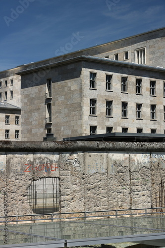 The Berlin Wall with the background of old buildings in West Berlin. © Maurizio
