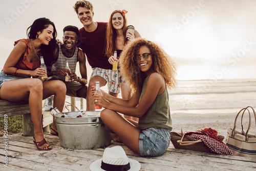 Friends hanging out at beach on vacation