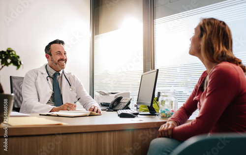 Friendly doctor consulting his patient