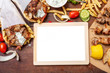 Leinwandbild Motiv Gyro pita, shawarma. Two pita bread wraps with meat, and blank board on wooden table, copy space