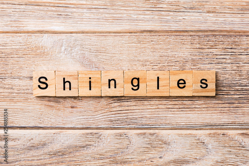 Shingles word written on wood block. Shingles text on wooden table for your desing, concept