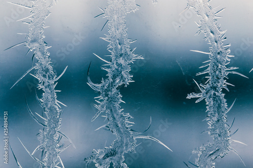 Snow patterns on glass as an abstract background