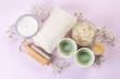 Leinwanddruck Bild - SPA concept - towel, salt, candle on pink background, copy space
