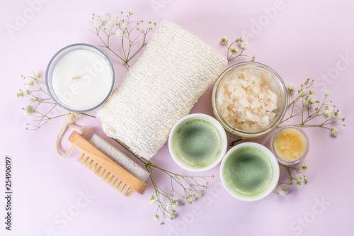 Leinwanddruck Bild SPA concept - towel, salt, candle on pink background, copy space