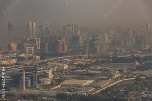 obraz lub plakat Dubai shrouded in a sandstorm as seen from the air