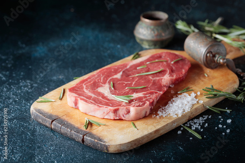 Fresh raw beef steak on wooden board. - 254925910