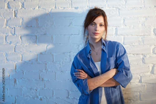 Young woman standing arms crossed