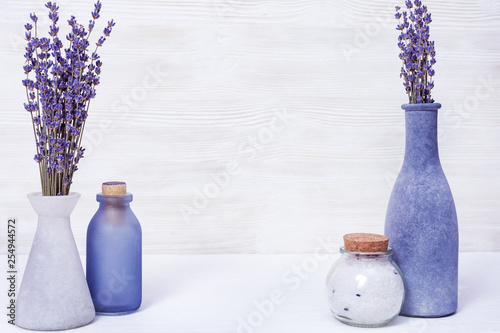 Lavender flowers and glass bottles, fragrant sea salt. Spa concept with copy space. Selective focus. - 254944572