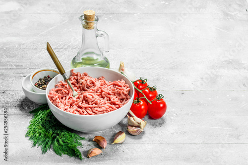 Raw minced beef with spices and herbs .