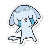 sticker of a cute cartoon dog crying