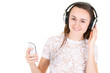 young glad woman listening to music on cellphone