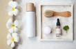 Leinwanddruck Bild - Face cream, serum, lotion, moisturizer and face oil among white frangipani in the bath