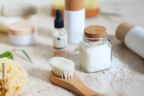 Leinwanddruck Bild Face cream, serum, lotion, moisturizer and sea salt  among bamboo leaves