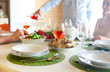 Leinwanddruck Bild - Table with rose wine, fish soup, salad and chiken