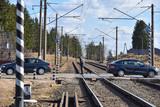 An elderly man crosses the railway crossing in Russia