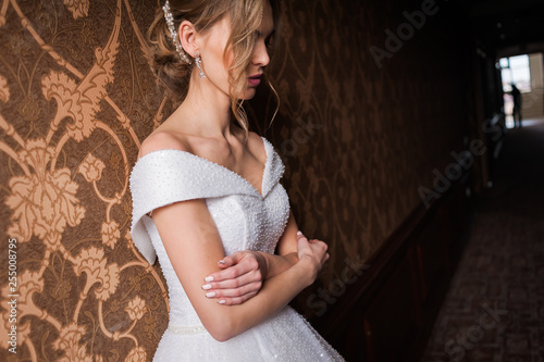 Bride.Young fashion model with perfect skin and make up  brown background  curly hair