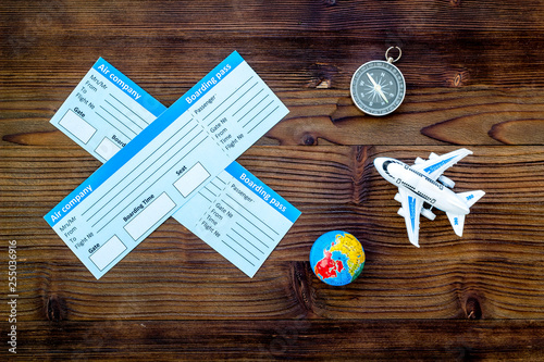 SOS Save the planet and ecology concept with the earth, compass, tickets and plane on wooden background top view - 255036916