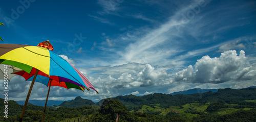 Rainbow umbrella on the blue sky. © jerd nakata