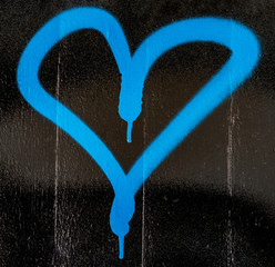 Blue heart graffito on an wall