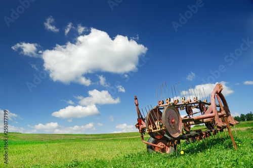 Agricultural machine on a green pasture