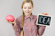 Woman holding idea sign and brain