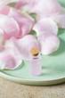 Leinwanddruck Bild - rose water in a glass bottle