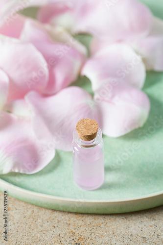 Leinwanddruck Bild rose water in a glass bottle