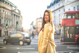 Beautiful elegant girl walking around in London
