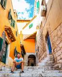 Rovinj colorful town Croatia men on vacation in Rovinj