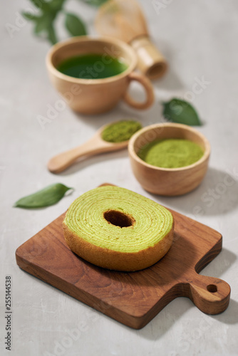 Green matcha Baumkuchen Japanese roll cakes with matcha, selective focus